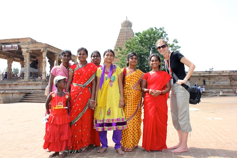 Brianne Miers with local women at Brihadeeswara Temple in Thanjavur, India