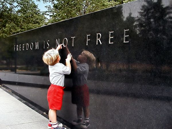 """Freedom""  - At the Korean War memorial in Washington D.C. - that is my youngest son who can't read yet but was very interested in the letters carved in the monument - the words speak for themselves...."
