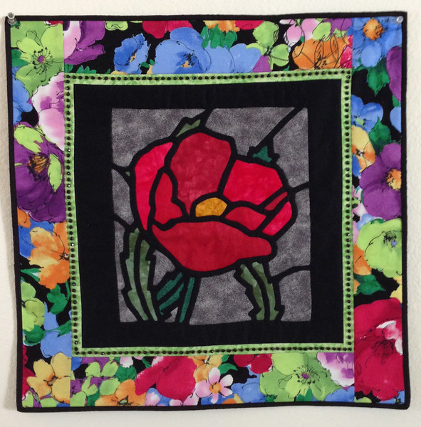 "2013 - Faithful Circle Nights<br /> 25"" x 25""<br /> Reverse applique rose out of UFO bin, finished with 3 challenge fabrics for Library Challenge and San Mateo County Fair"