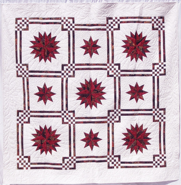 """2011 - Front Range Compass<br /> 78"""" x 78""""<br /> Quilted by Dianne Herrold<br /> Donated to Piecing Partners Quilt Guild 2012 Silent Auction"""