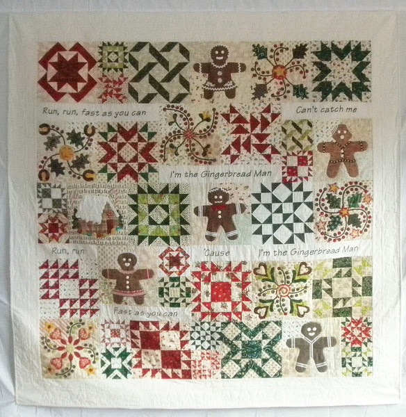 """2009 - Gingerbread Man<br /> 77"""" x 77""""<br /> Lots of fun with these blocks and the gingerbread people.  Machine pieced and appliqued and quilted."""