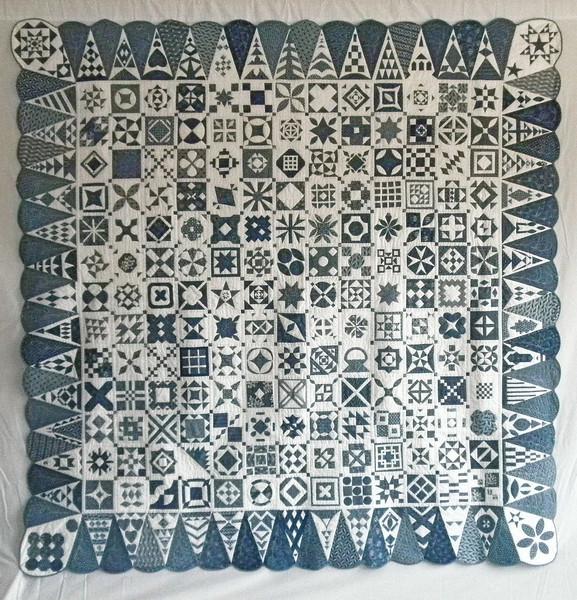 "2009 - Dear Jane<br /> 82"" x 82""<br /> 169 4-1/2"" blocks, 52 border triangles"