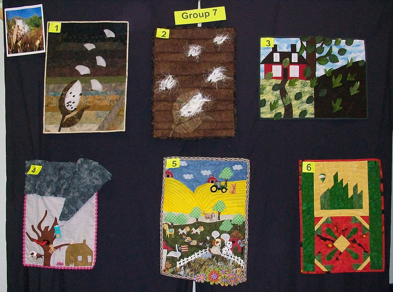 10/2010 Piecing Partners Whisper Challenge Group 7.  Quilter1-Milkeyweed pod seeds blowing in wind.  Quilter2-Again.  Quilter3-House and leaves blowing. Quilter4-Tornado (she's from Kansas).  Quilter5-Pastoral landscape.  Quilter6-Oz.