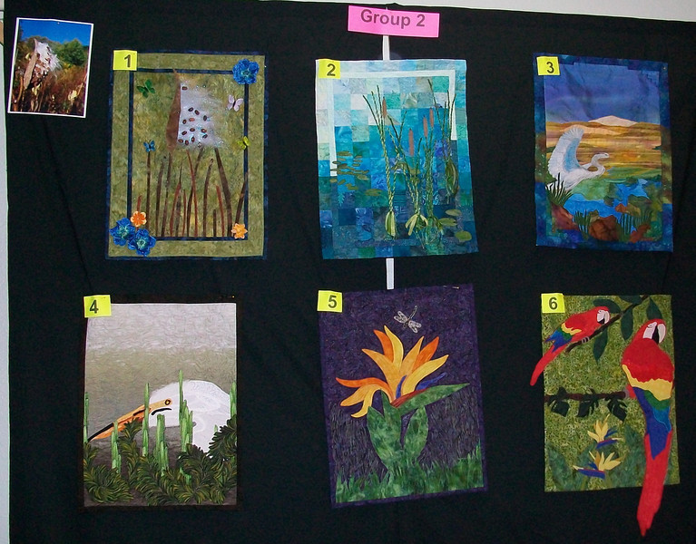 10/2010 Piecing Partners Whisper Challenge Group 2.  Quilter1-Minimalistic milkweed pod. Quilter2-Reeds. Quilter3-Egret by river. Quilter4-Egret hiding. Quilter5-Bird of paradise bloom. Quilter6-Parrots: birds of paradise.