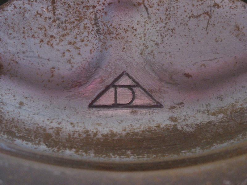 Dexter logo/trademark, found on the back side of Dexter wheels.