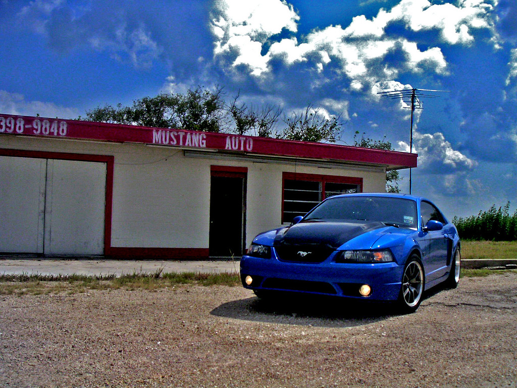 An abandoned dealership outside Mustang, TX.  I almost didn't stop, since I was in a hurry to get to College Station, but I'm happy I did, because that building has since been repainted and no longer says MUSTANG AUTO.  My second attempt at major post-processing.  Again, MINOLTA DIGITAL CAMERA