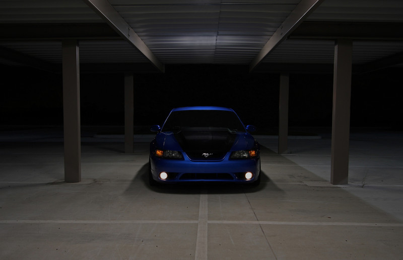 This one went through CS3 four times at the suggestions of others to get the final result.  I ended up removing background lights from buildings and the highway, reflections in the car, and finally the lights themselves in the roof of the covered parking.