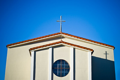 Our Lady of the Pillar Church in Half Moon Bay under perfectly blue sky