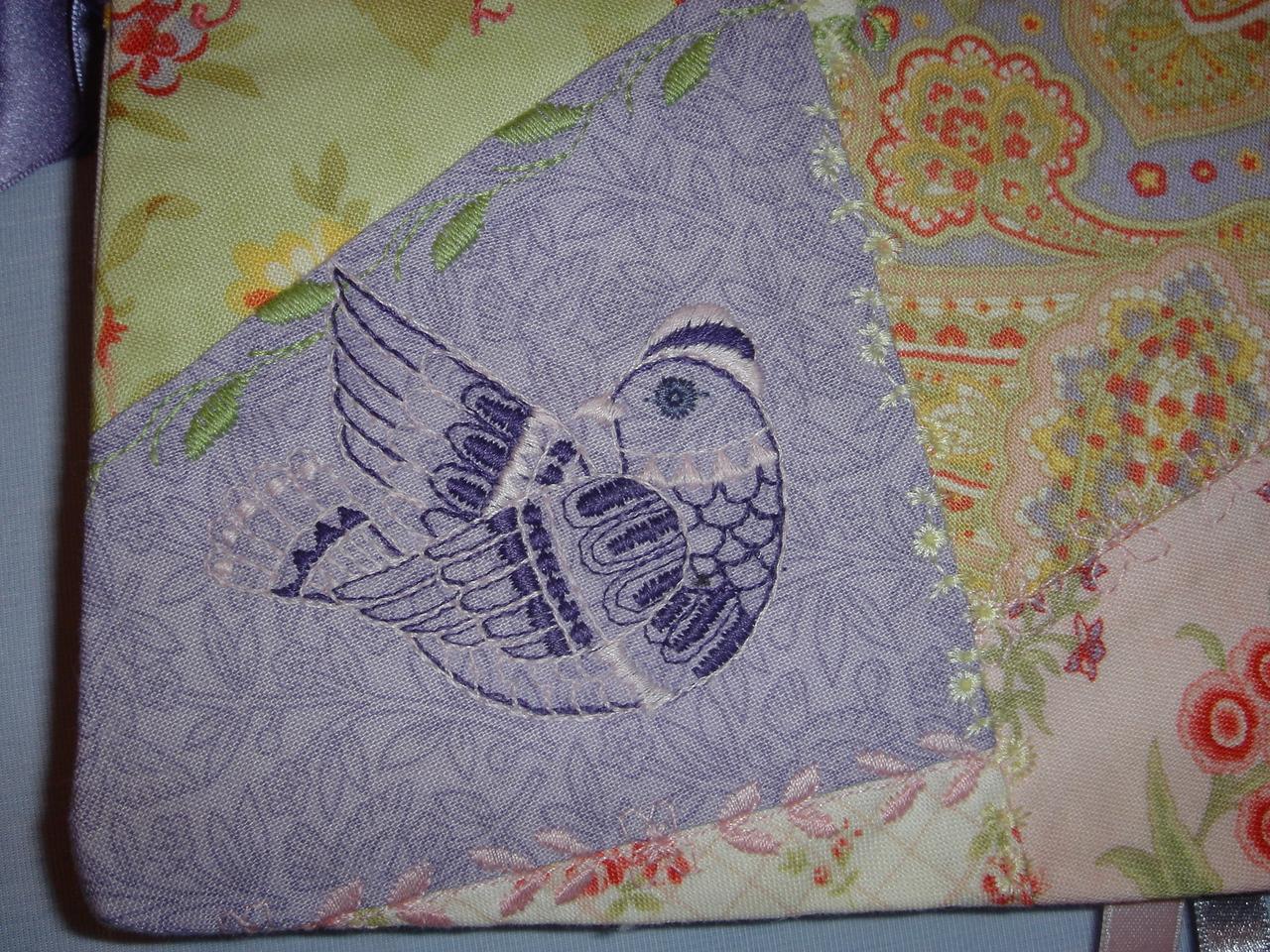 Closeup of bird embroidery