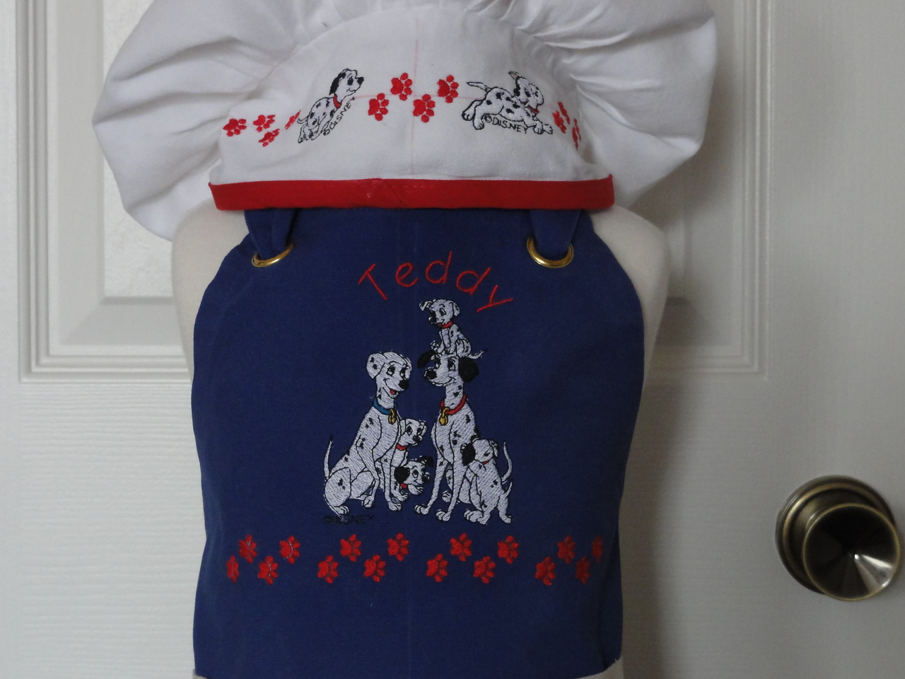 Closeup of hat & apron for Teddy