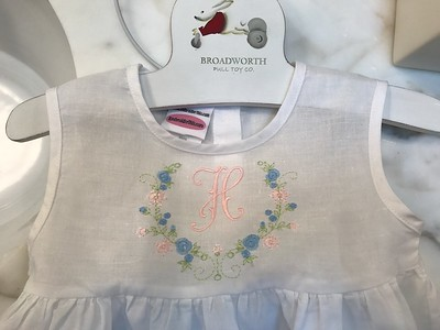 Monogrammed baby dress for Hayley, physio's daughter