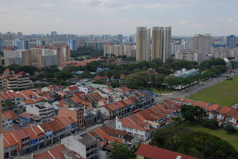 Pre-war houses around Serangoon area in the fore ground and apartment blocks stretching out a great distance in the background.