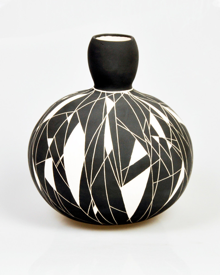 """5.  Black and white vessel, earthenware, hand built: h. 10 1/2""""."""