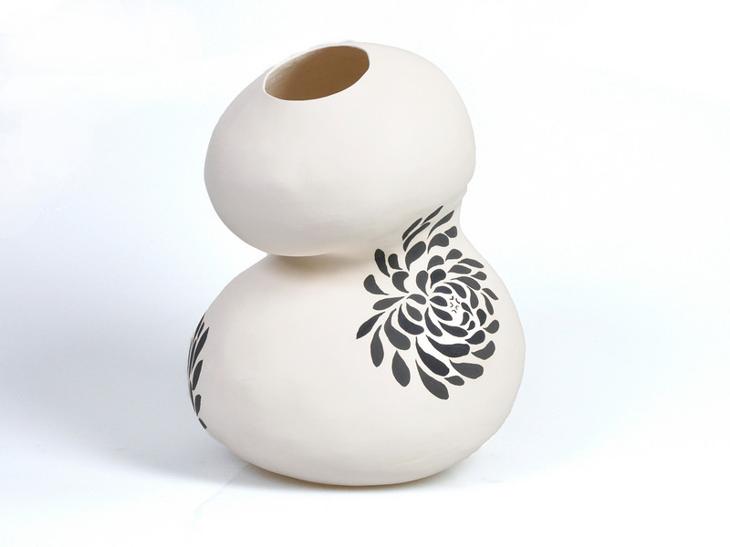 "1.  Black and white coiled vessel: 14 x 11""."