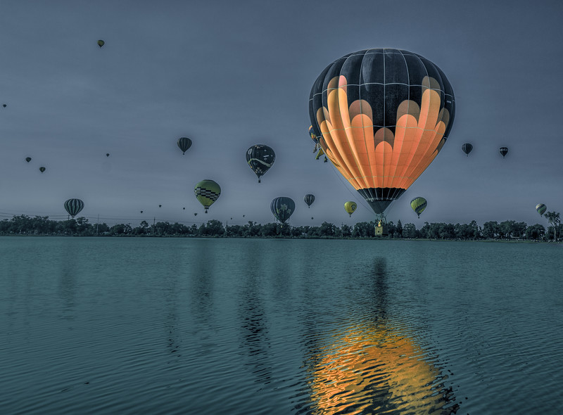 Callmly a Balloon Floats By