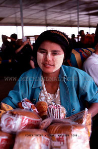 Woman Food Vendor on a Irrawaddy River Boat near Mandalay, Northern Burma. Client: Stock Photography Agency.