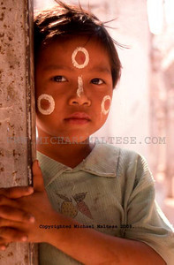 Young Boy Wearing Sun Block Poses for a Portrait, Inle Lake, Northern Burma. Client: Stock Photography Agency.