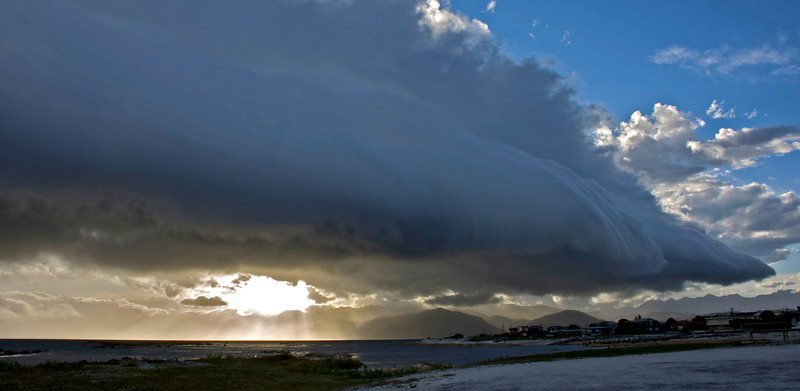 This must surely be one of the most 'scary' experience while at NZ. It was at Kaikoura. The wind suddenly picked up and got stronger and stronger. This wall of cloud started off further out but began billowing at fast speed. The front end of the cloud you see here was rolling and the mass of white just came closer as if to engulf.  Just like a sci-fi movie when you half expect a huge spaceship or something to emerge.   A really surreal evening!