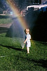 In this picture Kendon was playing in the sprinkler at my parents house. The rainbow you see is a real rainbow coming thru the droplets from the sprinkler. It was not added with a artificial filter or added digitally. It is God's own artistry that I captured on film.