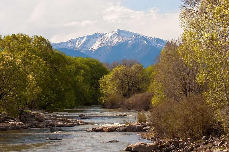 Mt. Shavano, one of Colorado's 56  fourteen thousand feet high mountains. Arkansas river near Salida, CO in foreground. June, 2010.