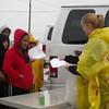 Healing Hearts Across Borders...dispensing Meds in the rain