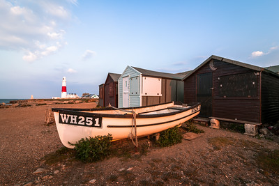 Boat and the Lighthouse at Portland Bill, Portland, Dorset, England