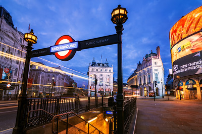 Piccadilly Circus Subway and passing bus, Sunrise Cityscape, London, England
