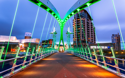 Blue Hour, Lowry Bridge, (Salford Quays lift bridge or Salford Quays Millennium footbridge), over the Manchester Ship Canal, Salford Quays, Media City, Manchester, England