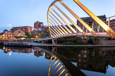 Illuminated Merchants Footbridge, Castlefield Basin. Deansgate, Manchester, England