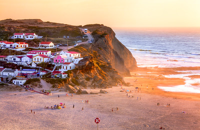 Beautiful sunset reflecting on the cliffs at Praia Monte Clerigo, near Aljezur, West Coast, Algarve, Portugal