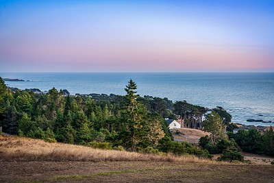 Twilight Telephoto View of White Barn