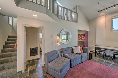 Living Room and Stairs to Bedroom