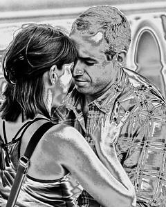 Prague, Czech Republic - Two lovers talking romantically on a bridge in Prague.
