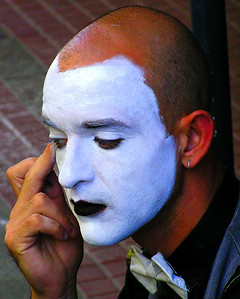 Buenos Aires, Argentina -  A street mime in Recoleta putting on his makeup before the crowd arrives to see him perform