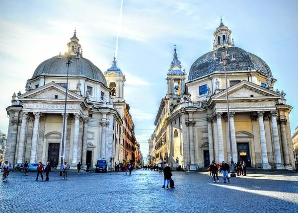 "The ""twin"" churches of Santa Maria in Montesanto (left, built 1662-75) and Santa Maria dei Miracoli (right, built 1675-79). The Via del Corso exits between the two churches. - Roma"