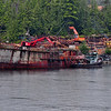 A logging operation using a rusty old ship near Ketchikan.