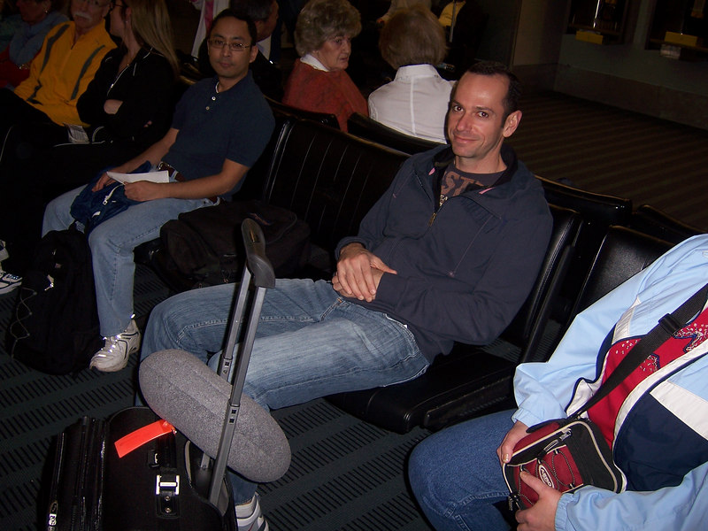 "The obligatory ""Ted Waiting for the Red-Eye Flight"" photo.  We had a medical emergency for a second year in a row.  Ken is seated next to him.  He was also on our flight."