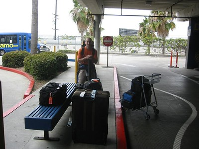 David with our luggage waiting at the rental car place in San Diego.