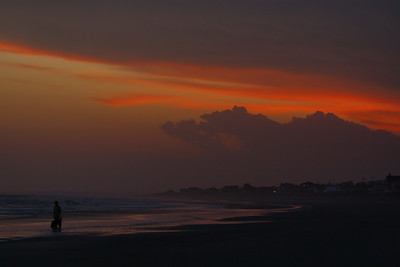 Sunset at folly Beach, SC with storm clouds coming.  http://www.follybeach.com/
