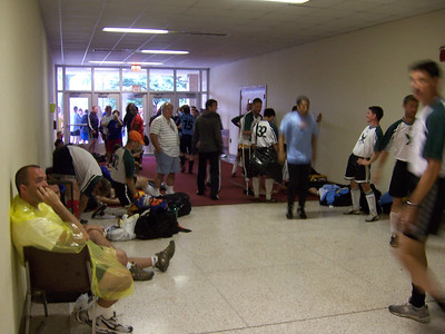 The soccer teams wait for the thunderstorms to clear