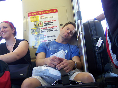 The long train ride to the airport had the benefit of this hot guy sitting near me.  When he dozed off I snapped this photo.