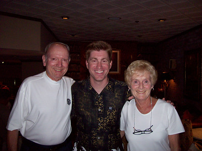 Here's me with my parents right after I surprised them.  I found out where they were having dinner and showed up.  They had no idea.