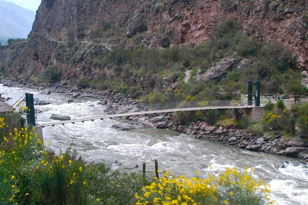 Foot bridge on the Rio Urubamba in Peru