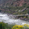 Foot bridge on the Rio Urubamba in Peru