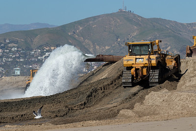 The H.R. Morris dredge and support dozers in action at Ventura Harbor.