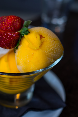 Mango and Lime dessert, topped with a strawberry
