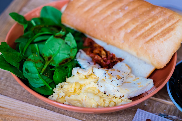 Scrambled eggs, halloumi cheese, sundried tomato with sourdough toast at Lid & Jar