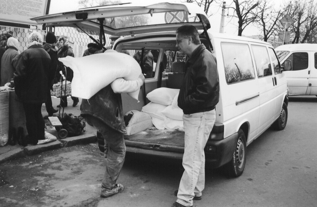 Alex Emes - Observing a food shipment for orphans in Korosten, Ukraine. Copyright © Alex Emes