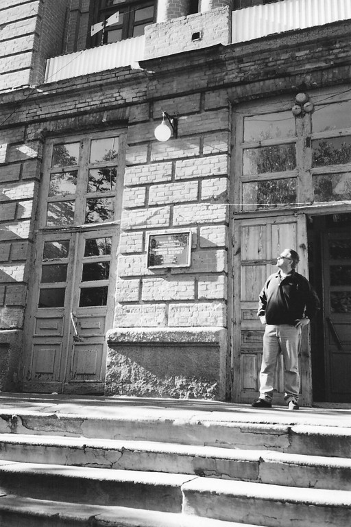 Alex Emes - Stepping outside of an orphanage in Eastern Europe. Copyright © Alex Emes