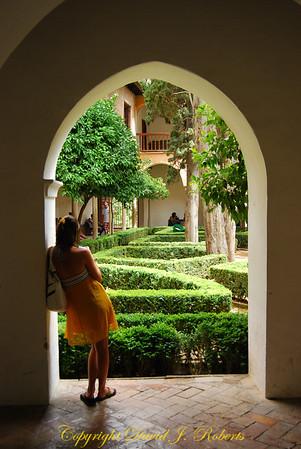 Rachel in the archway to a beautiful garden, Alhambra, Grenada, Spain